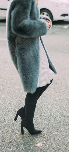 chic street style. pointed boots. fluffy coat. pleated skirt.