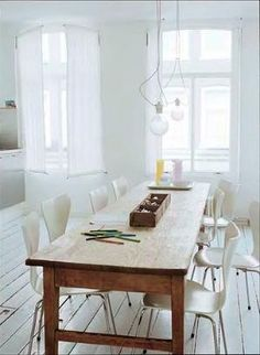 Beat up old farmhouse table with modern chairs. Fabulous. by leila