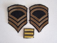 A set of three air force patches from World War II. There are two arm patches with five stripes black and gold (brown). And a overseas service patch green and gold given for deployment.   Measurements:  Arm Patches: 4 1/4 inches tall x 3 inches wide  Deployment Patch: A little over 1 inch x 1 inch