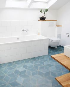 Simple and beautiful; this bathroom of Christina Zemanova and Aske Munck has Diamond concrete tiles on the floor in the color North Sea. Bathroom Floor Tiles, Bathroom Renos, Bathroom Colors, Bathroom Renovations, Bathroom Interior, Small Bathroom, Colorful Bathroom, Bathroom Remodelling, Bathroom Plants