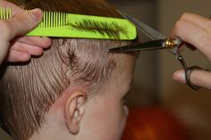 Cutting boy's hair. I need to study up, K has some long hair already. So it's either surfer dude, or I learn this!