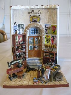 Nicola il ciabattino. Tutte le miniature sono realizzate con pasta modellabile, listelli di legno, filo di ferro e stoffa. Autore: Paola Verderio