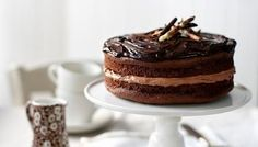 Chocolate fudge cake: rich, moist and treacly with a glossy ganache finish
