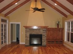 Vaulted ceiling in this expansive great room.  Craftsman House Plan # 351240.