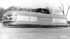 The Air Car was built of welded steel tubing covered by molded sheet metal. It was powered by two 180hp Lycoming engines mounted one forward and one aft of the passenger compartment.  Each engine was used to drive, via reduction gears, a single four-bladed lift fan placed within a plenum chamber. The two chambers created a cushion of air 10-15 inches thick. Forward propulsion was supplied by air bled off the chambers