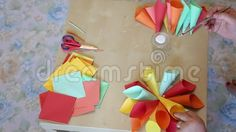 Making paper cones colorful shaped flower.