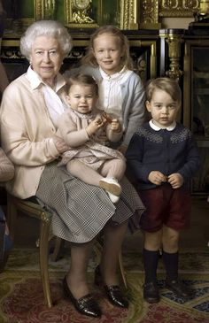 (back-R) Savannah Phillips, Princess Charlotte on Queen Elizabeth lap wearing a dress from the brand's Autumn Winter collection while her brother Prince George wore his standard uniform of shorts, knee socks and a patterned jumper in the Queen's 90th birthday portrait