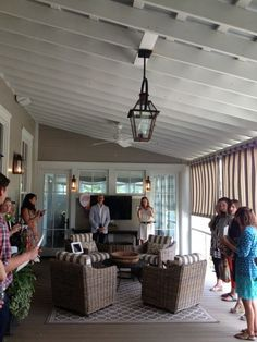 """The enclosed back porch is nestled between the master bedroom and the dining room.  It offers another """"room"""" to relax and entertain in when the weather is cool and you need a little more space."""