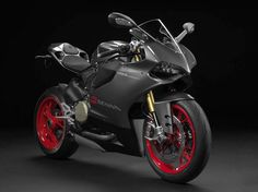 Ducati will be introducing a new, special edition of its 1199 Panigale S, in honor of Ayrton Senna. This is the fourth tribute bike Ducati has offered since Senna's death in Moto Ducati, Ducati Logo, Ducati 999, Ducati 1299 Panigale, New Ducati, Ducati Motorcycles, Ducati Superbike, Hypermotard Ducati, Sport Motorcycles