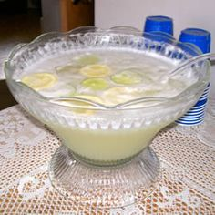 Non-Alcoholic Margarita Punch --- 1 (12 fluid ounce) can frozen lemonade concentrate;  1 (12 fluid ounce) can frozen limeade concentrate;  1 cup confectioners' sugar;  4 egg whites;  6 cups crushed ice;  1 liter carbonated water;  1 lime, sliced;  coarse salt