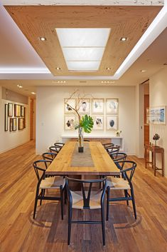 Dining room with chandelier of bleach and spalted beech.  Floors are bleached and wire brushed teak.  Interior design by Matrix Design Studio