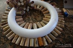 How To... Cork Wreath | from Living Savvy After I knew THIS idea was going to work I started to fill in the inside and the outside to give me a circler pattern to follow.  I plugged in all of the corks as flush as possible to keep the back smooth.