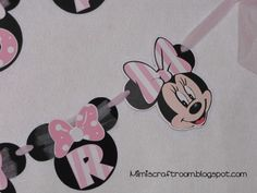 Pink and white minnie mouse made using Mickey Font and Mickey and Friends Cricut cartridges,  See my blog for instructions.