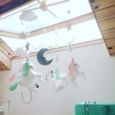 A mint and pink version of my felt unicorn mobile hanging in my studio! #unicornmobile #secretcrafthouse #unicorn #unicornnursery