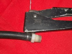 Pop Riveter Clamping Tool by graydog111 -- Homemade clamping tool adapted from a manual pop riveter. A looped piece of wire, intended as a hose clamp, is tensioned and twisted by the riveter, with the excess cut off and folded over. http://www.homemadetools.net/homemade-pop-riveter-clamping-tool