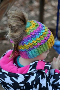 This is a PDF crochet pattern for a beanie with a hole in the top to allow for a ponytail or messy bun. The hole uses an elastic hair tie to stretch over a bun but still stay snug for a ponytail. Keep your hair up and out of the way but still stay warm! This pattern coordinates perfectly with my Charisma Mittens pattern.