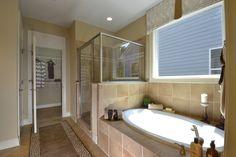Dogwood Master Shower Tub with frameless enclosure and makeup desk ILO tub
