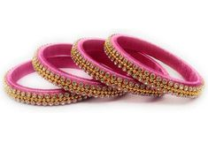 These pretty pink and golden silk thread bangles. We make handmade silk thread bangles based on your orders which looks pretty on every dress and is good for every occasion. Silk Thread Earrings Designs, Silk Thread Bangles Design, Silk Bangles, Fabric Earrings, Thread Jewellery, Designer Earrings, Designer Bangles, Anklet Designs, Pink Silk