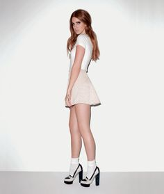 Lana wears Armani top, Opening Ceremony skirt and Charlotte Olympia for Peter Som shoes here in this magazine shoot.