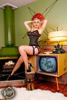 Nothing against the woman, but I'll take the TV, the panther lamp, and the wall art. Thanks.