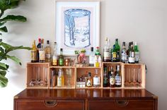 The bar area features a bar print from Maple Sizzurp by Whatisadam from Station16 Gallery.