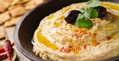 Creamy, thick, and oh-so-easy to make, you'll never buy hummus again once you try this recipe!
