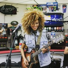 Andy Allo rocked a convenience store in Anaheim. Unannounced. How cool is that? *I love rocking out with my fro during a good guitar solo! It moves around a lot – my assistant calls it 'fro-motion.* Andy's curls? ♡, Decadence!