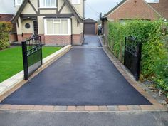 Heres another tarmac driveway but with a block paving border.
