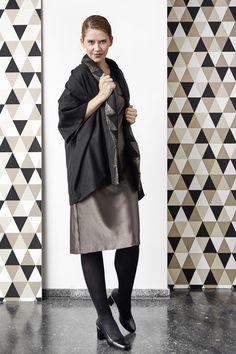 Kimonojacket wit geometrical details.