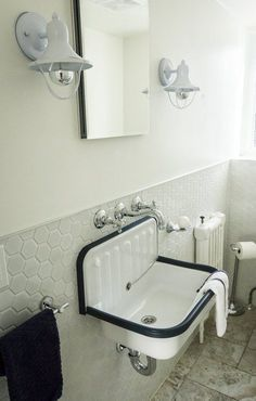 industrial bathroom with hexagon-tiled wainscoting