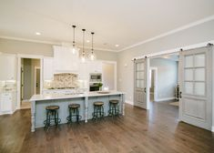 Open concept kitchen with large kitchen island and sliding barn doors Family Dining Rooms, Small Living Rooms, Home Decor Kitchen, Kitchen Design, Modern Log Cabins, Living Room Floor Plans, Glass Dining Table, Open Concept Kitchen, Paint Colors For Living Room