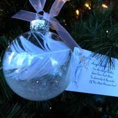 s 23 breathtaking ways to dress up a plain plastic or glass ornament, christmas decorations, seasonal holiday decor, Add feathers to make one angelic Glass Ornaments, Diy Ornaments, Clear Plastic Ornaments, Memorial Ornaments, Globe Ornament, Homemade Ornaments, Ornament Crafts, Homemade Decorations, Glitter Ornaments