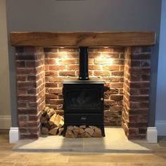 Brick Fireplace Log Burner, Exposed Brick Fireplaces, Home Fireplace, Fireplace Surrounds, Fireplace Design, Wood Burner Stove, Tiled Fireplace, Brick Hearth, Cottage Fireplace