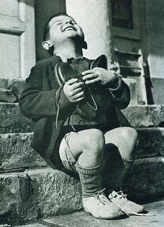 """New Shoes"" by Gerald Waller, Austria 1946,via flickr. ~~~ Six year-old Werfel, living in an orphanage in Austria, hugs a new pair of shoes given to him by the American Red Cross.    This photo was published by Life magazine. via Flickr."