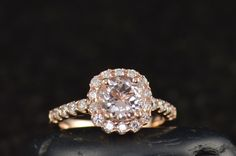 I WANT THIS RING SO BAD!!! Morganite Engagement Ring in Rose Gold, 1.25ct Round Brilliant Morganite Center in Cushion Cut Shaped Diamond Halo, Fit Flush Design, Sophia by DiamondDoveJewelry on Etsy https://www.etsy.com/listing/264186854/morganite-engagement-ring-in-rose-gold