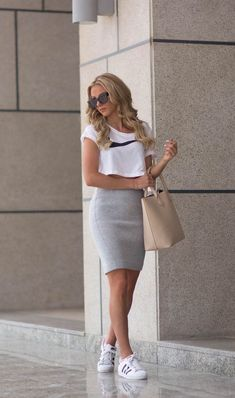 Sendi Skopljak is wearing a white crop top from Nike, grey skirt from Gina Trico. - Sendi Skopljak is wearing a white crop top from Nike, grey skirt from Gina Tricot, shoes from Adidas and the tan bag is from Bershka Source by - Mode Outfits, Casual Outfits, Fashion Outfits, Womens Fashion, Fashion Trends, Sport Fashion, Jackets Fashion, Casual Jeans, Fashion News