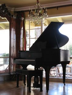 Black Baby Grand. This is what I took piano lessons on for 15 years. Looked just like this in front of windows. Would love to have one!