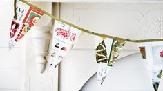 festive christmas card bunting made with old christmas cards - yes, it is march and i still have our christmas cards on the wall - i might just make this with them and then pack it away for next year!