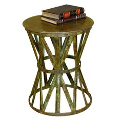 Openwork iron side table.    Product: End table   Construction Material: Metal  Color: Distressed rust...