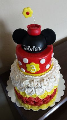 Minnie Mouse cake in red, white and yellow www.facebook.com/simplycakes.brittneyshiley