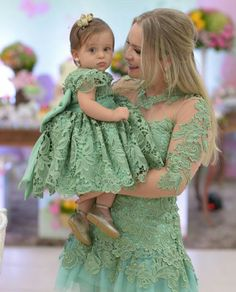 Mother and daughter in green dresses