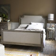 LOUIS Made from hand-carved solid oak which is given a weathered finish, this French beauty is the work of artisans. Upholstered in natural linen, this bed is every bit as beautiful as an original. Sprung birch slats included. Order yours from Loaf here: http://loaf.com/products/louis-bed