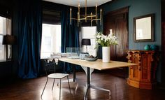 Richer colors do absorb light, but deep, dark, and cozy may be just the thing you're going for. | 23 Stunning Color Tips To Make Your Small Space Feel Much Bigger