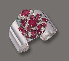 Platinum, Carved Colored Stone and Diamond Clip-Bangle Combination, Cartier, circa 1925