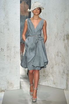 This Donna Karan dress is FABULOUS! Its back-less ;) I'm wearing it to a wedding this summer.