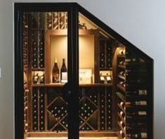 Custom built steel and glass door for this compact wine cellar that we artfully tucked away underneath the stairs. Under Stairs Wine Cellar, Home Wine Cellars, Wine Cellar Design, Basement Inspiration, Basement Stairs, Basement Ideas, Stair Storage, Wine Storage, In Vino Veritas