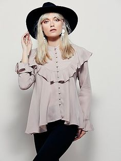 Molly Ruffle Buttondown Top | Super luxe silk blouse featuring button closures down the front and statement ruffle detailing.  High low hem and fared cuff on the sleeve.