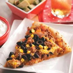 Tex-Mex Pizza. Modified it a bit...chicken instead of beef, no olives or sour cream canned versus frozen corn, and added some pizza sauce with the salsa...Colby threw it on the grill, YUM! Ok, so maybe it wasn't exactly this recipe...just inspired by it! lol