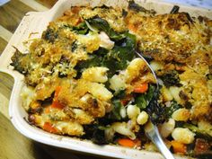 I'll use a variety of dark leafy greens for this wonderful sounding :Collard Green and White Bean Gratin.