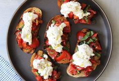 Tomato and Burrata Bruschetta is the cross between pizza and an amazing piece of fresh tomato toast. Try your best to not eat all the creamy cheese. Caprese Salad, My Favorite Food, Favorite Recipes, Creamy Cheese, Light Recipes, Sweet Recipes, Appetizers, Appetizer Ideas, Italia